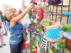 Yarn bombing with a twist - each crocheted vessel contained a succulent plant so that the end result was a colourful hanging garden.