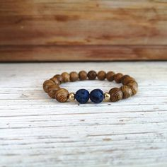 Wenge Wood and blue electroplated lava stone diffuser bracelet, gold Hematite spacers Wenge Wood, Lava, My Etsy Shop, Stone, Bracelets, Check, Gold, Blue, Accessories