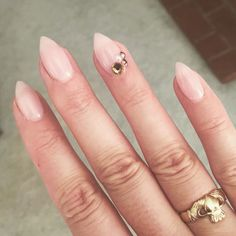Nude stiletto nails with crystals
