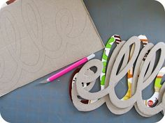 Name Decor idea - using carboard/cereal boxes, ModPodge, & scrapbook paper