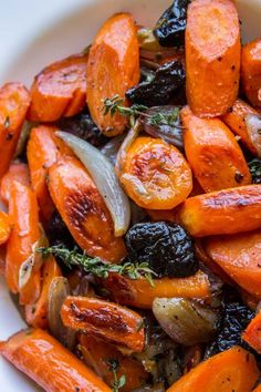 These tender carrots are roasted in apple cider sweetness that gives them an incredible glaze! Halfway through roasting, add a handful of dried plums. It's an awesome combo and perfect with the turkey and gravy Plum Recipes, Carrot Recipes, Side Recipes, Yummy Recipes, Vegetable Side Dishes, Vegetable Recipes, Vegetarian Recipes, Vegan Meals, Roasted Carrots