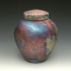The Celestial Blue Raku Cremation Urn is handmade by an artisan and finished in the traditional Raku ceramics process. An elegant memorial, made in the USA.