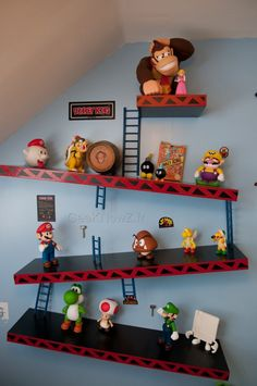 Excellent idea for oldest child's bedroom! He can use this to display all his Nintendo figures. It would look awesome with his Zelda posters and gamer theme.  I plan on making this by purchasing black floating shelves and cutting red vinyl.