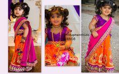 Kid in orange and violet half Saree