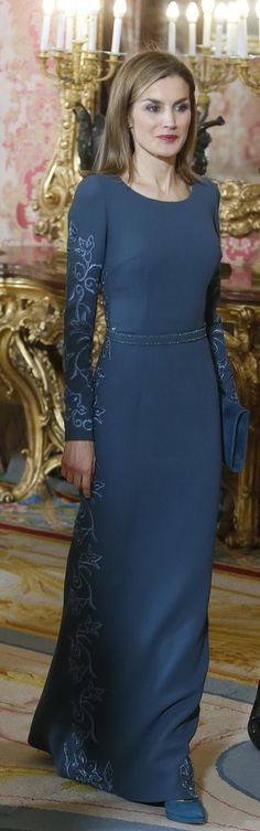 Queen Letizia attends the Pascua Militar (New Year's Military Parade), Royal Palace, Spain, January 6, 2015. It is customary for royal women to wear a full length dress to the Pascua Militar ceremony, today Queen Letizia opted for her Felipe Varela teal gown. The bespoke gown features embroidery down the sides and a beaded tonal belt at the waist. The long sleeve dress has a a scoop neckline and it is fabricated from double crepe wool.