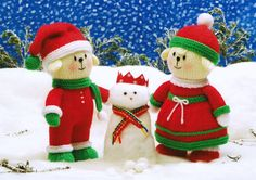 """'Christmas Boy and Girl' from Jean Greenhowe's 'Playful Puppies' pattern booklet. They would definitely make a Happy Christmas even happier. Knitted in DK they are easy to make and arew 21cm/8.25"""" tall (excl hats). The booklet was published in 2013."""
