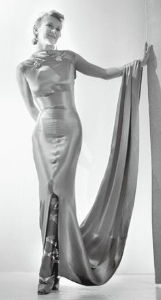 1937, Schiaparelli evening gown with laced ballerina shoes gold silver lame gown dress long 30s platform shoes heels straps photo print ad model magazine long train sleeves