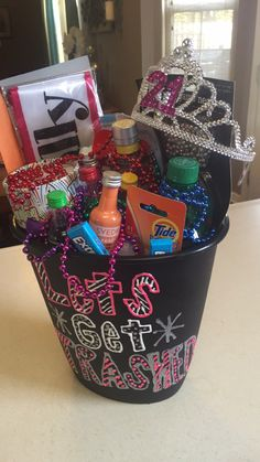 "21st birthday gift! In a trash can saying ""let's get trashed"" filled with all the necessities needed for the eventful evening and the morning after. More"
