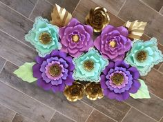 Items similar to Specialty Paper Flower Backdrop flowers) purple, mint and gold on Etsy How To Make Paper Flowers, Large Paper Flowers, Specialty Paper, Paper Flower Backdrop, Different Flowers, Flower Making, A Table, Backdrops, Centerpieces