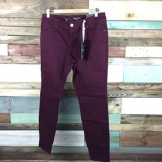 """NWT  The Limited Wine Legging Jean - sz 12 NWT  The Limited Wine Legging Jean - sz 12 Our modern 678 fit sits low on waist, is slim through the hip and thigh. Luxuriously soft, these polished jeans are so comfortable, yet oh so stylish. Soft brushed twill 5-pocket styling with rivet detail Inseam: 30"""" / Waist:17"""" Flat / Rise"""" 9"""" 80% Cotton/ 17% Rayon/ 3% Spandex. Machine wash. Tumble dry.  #woodsnap #wine #maroon #coloreddenim #softlegging #denim The Limited Pants Leggings"""