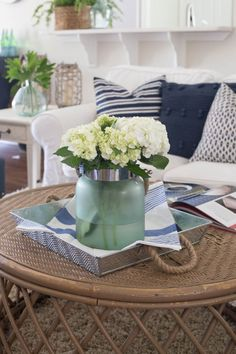 Decorating for Summer - A Home Tour   Simple home decor   blue and white pillows, lots of flowers and green plants