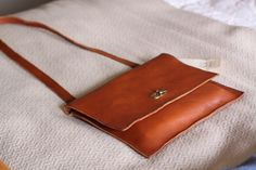 20dd1ef39c The Mandolin Sequoia is a smartly structured crossbody finished with a  fold-over flap and
