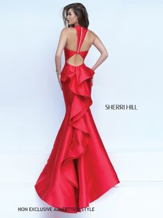 You'll be red carpet ready when you arrive wearing this stunning Sherri Hill 50195 prom dress in Ivory, Red, Black, Teal, Coral, Light Blue, Magenta, or Yellow. This satin silhouette features big, beautiful ruffles that cascade down the back of the gown. The unique back design ties it all together for an ultra-alluring look!