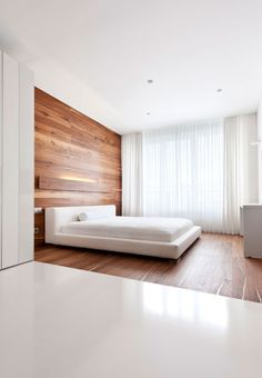 Modern White Apartment Interior by Alexandra Fedorova | HomeDSGN  Very crisp interior with sharp detailing, brilliant use of the warm wooden panelling to soften the harshness of the white color scheme