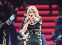 LONDON, ENGLAND - FEBRUARY 10: Seven-time Grammy winner Taylor Swift on the fifth night of the European leg of her blockbuster The RED Tour with the fourth of five sold-out shows at London's O2 Arena, playing to a capacity crowd of more than 15500 fans, on February 10, 2014 in London, England. (Photo by Dave Hogan/TAS/Getty Images for TAS)