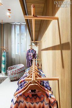 Molto Missoni: Urquiola Dresses Up Milan Flagship   Women's clothes hang from custom rods of tinted galvanized steel. #design #interiordesign #interiordesignmagazine #architecture #retail #fashion