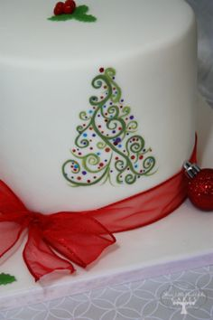 Christmas celebration cake with hand-painted abstract Christmas tree. Cake is 8 inch Gingerbread cake with Vanilla swiss meringue buttercream, covered in white chocolate ganache and vanilla fondant.