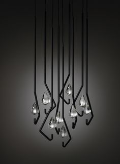 ONE CRYSTAL CHANDELIER date: 2011 type: pendant lamp material: steel, crystal size: 150 x 600 x 50 mm design: Thomas Feichtner producer: J. & L. Lobmeyr, Austria