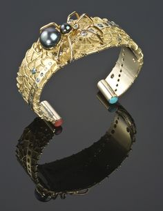 Cuff | Jesse Momongya. 14k gold black pearl spider with turquoise and coral