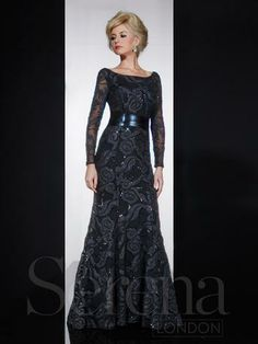 Mother of the Bride dress Serena London 20145. Satin cutwork design on stretch net gown with a scoop neck, long sheer sleeve, high back and trumpet skirt with a faux leather wide belt. Satin cut work.
