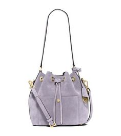 Exclusively Ours in Michael Kors stores and on michaelkors.com until 4/31/16. The perennially cool bucket bag has never looked more sumptuous. We've reinvented our iconic Greenwich in soft suede for a bohemian feel. Striking the perfect balance between laid-back and luxe, this piece will be one to covet for this season and beyond.