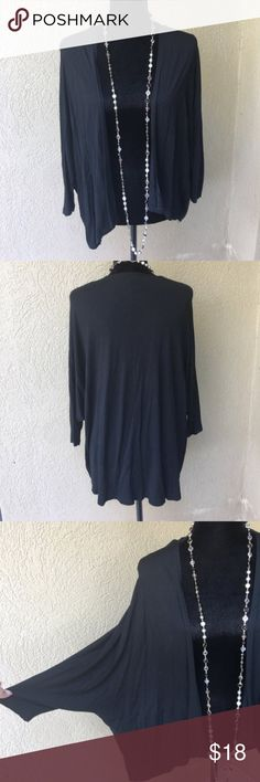 Cotton On Black dolman sleeve lightweight shrug This black loose fitting open front medium length shrug is a closet staple! Need a quick throw over for an evening outside when it gets cooler, need something to cover your bare shoulders at the office- just need a casual chic addition to your outfit? This is the piece!! Longer in the back drapes in the front. EUC Material content tag has been removed- feels like tshirt material ✅I ship same or next day ✅Bundle for discount Cotton On Sweaters…