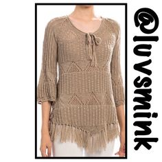 TAN SWEATER LARGE Intricate crochet and lace insets, along with bell shaped sleeves, help to enhance the beauty of this soft knit top. A self tie keyhole in the front with a self tie tassel.  The bottom edge of the gorgeous top has a soft fringe all the way around. Available in Small, Medium, and Large.  100% Acrylic,  33 inches long. THIS IS A SIZE LARGE Double Zero Sweaters Crew & Scoop Necks