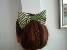 Loop bun with triple Braids and a Bow