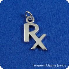 This Pharmaceutical RX Symbol Charm comes with a silver jump-ring as pictured.