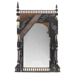 A CARVED WOOD, BRASS AND BONE MIRROR, DESIGNED BY BUGATTI, EARLY 20TH CENTURY;