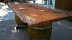 Wine Barrel Slab Table for picnic table on porch...  go to Jack Daniel's Distillery to get whiskey barrels?