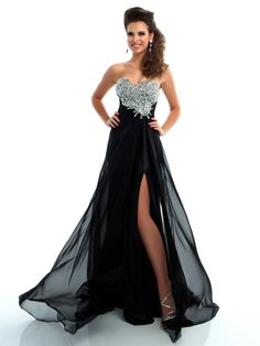Elegance has never looked better in this striking gown. This floor length Mac Duggal Flash Prom Dress 64357 features a sweetheart neckline, heavily beaded bust, and a ruched band with beaded accent on the side. Completing the look of this prom dress is a flowing A-line skirt with high side slit. This prom dress comes in these colors: Cherry and Black/Silver. Add gorgeous earrings to complete this beautiful gown.