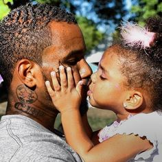 Hip-Hop Artist The Game Kissing His Daughter Cali