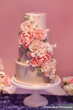 Gorgeous Wedding Cake with gumpaste floral cascade.  photgraphy by@chelsea_nicole_  www.gimmesomesugarlv.com #weddingcake #lasvegasweddings #floralcake