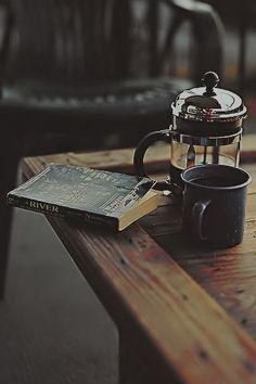 coffee and a good book. Coffee imposter on a tea board!