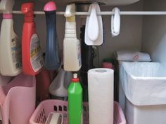 Tension rod under the sink for hanging bottles = extra storage!! BRILLIANT!!!!    I did this and it's amazing how much room it gives you!!