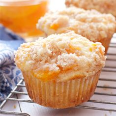 These Peach Cobbler Muffins are the perfect sweet snack! This is such an easy recipe that taste's just like Grandma's peach cobbler! They're even easier to make than a traditional cobbler and have the perfect crumble topping! Peach Muffins, Cupcakes, Crumble Topping, Artisan Bread, Muffin Recipes, Breakfast Recipes, No Bake Desserts, Bakery, Easy Meals