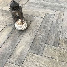 Herringbone flooring is a type of flooring design that used to resemble the appearance of herring's bones. Each plank comes in a rectangular shape. Herringbone wood flooring design is one of the most if not the most popular design around.