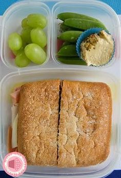 Italian cold cut sandwich on ciabatta bread, peas and hummus and some grapes.