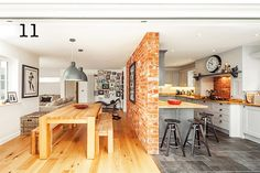 American-style kitchen remodel zoned using brick partition and different flooring