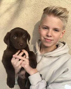 Carson lueders and puppy