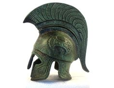 - Spartan Hoplite Helmet - Ancient Greek hoplite helmet from the famous city of Sparta, dated 480 B. Characteristic for a helmet of Spartan origin is the austere short cresτ. Handmade in Greece of solid bronze, an exact museum reproduction . Ancient Greek Art, Ancient Greece, Ancient History, Elmo, Greco Persian Wars, Greek Helmet, Spartan Helmet, Greek Warrior, Mycenae