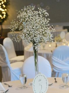 Mrs. Powder Puff's baby's breath centerpieces.