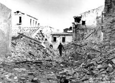 Ortona - The ruins could hide snipers or heavier weapons. The rubble could stop a tank. Boobytraps and mines could be anywhere. (This photograph was taken after the fighting at Ortona had ended. Canadian Soldiers, Canadian Army, Canadian History, Ghost Images, World War Two, Ww2, Snipers, Battle, Canada