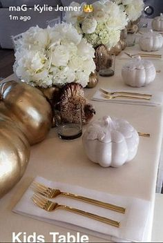 So chic: The table was adorned with white roses and gold trimmed china