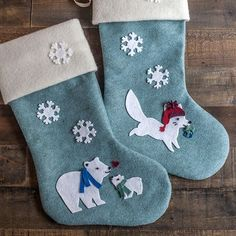 These diy felt Christmas stockings in our Artic theme are quite simple to make and are so nice to the touch.