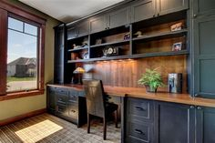 Home office - painted black with open adjustable shelves and wood top.  (Cabinetry by Modern Design)
