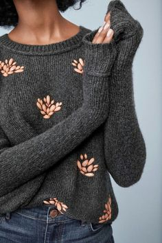 I love this sweater the grey with touches of color to brighten it up. Would