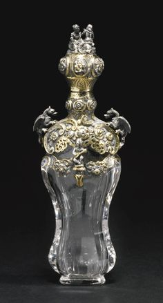 A parcel-gilt silver and glass perfume bottle, apparently unmarked but probably J.V. Morel, Paris, circa 1840.