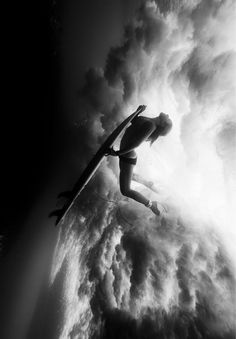 Underwater flight. ride4life. beachlife. evade. delight. deliver. surf. surfing. black and white.